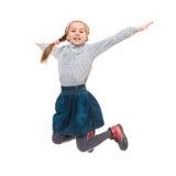 Foto del salto alegre de la niña Fotos de archivo libres de regalías
