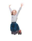 Foto del salto alegre de la niña Fotos de archivo