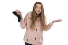 Foto dell'adolescente confuso con la scarpa Immagine Stock