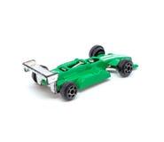 Foto dell'automobile di modello del giocattolo verde isolata su fondo bianco Immagini Stock