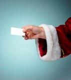 Foto della mano di Santa Claus con un biglietto da visita Fotografie Stock