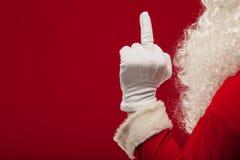 Foto della mano gloved di Santa Claus nell'indicare gesto barrette fotografia stock