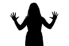 Foto della siluetta della donna con le mani aperte Fotografie Stock