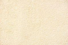 Foto della struttura grungy della parete dello stucco giallo immagine stock