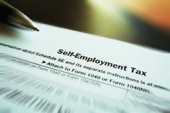 Foto delle azione della forma di lavoro indipendente di imposte Fotografia Stock