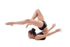 Foto dello studio della ragazza flessibile che posa alla macchina fotografica Fotografia Stock