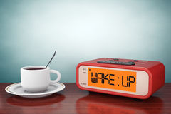 Foto der alten Art Digital-Wecker mit Kaffeetasse Lizenzfreies Stockfoto