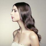 Foto der schönen jungen Frau. Weinleseart Lizenzfreie Stockbilder