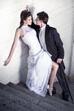Foto der schönen Kunst eines attraktiven Hochzeitspaares Stockfotografie