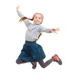 Foto des frohem Springens des kleinen Mädchens Lizenzfreie Stockfotos