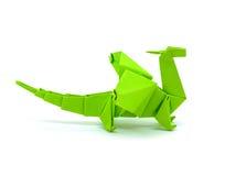 Foto des grünen Drachen des Origamis lokalisiert auf weißem Hintergrund Stockfotografie