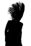 Foto des Schattenbildes des Mannes mit dem Schlaghaar Lizenzfreie Stockfotografie