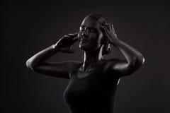 Foto di arte di bella donna con trucco nero Immagini Stock
