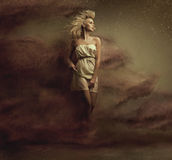 Foto di arti di una bellezza bionda di fascino Fotografia Stock