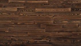 Foto di legno naturale per fondo o struttura, colore di marrone scuro immagine stock