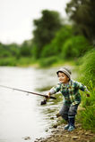 Foto di pesca del ragazzino Fotografia Stock