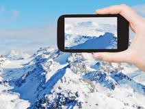 Foto di presa turistica delle montagne della neve in Alpes Fotografia Stock Libera da Diritti