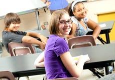 Foto di riserva degli allievi felici del banco Fotografie Stock