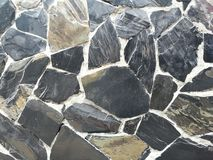 Foto di riserva del fondo di superficie della parete di pietra della roccia fotografie stock