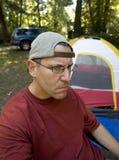 Foto di riserva di un campeggiatore infelice Fotografie Stock