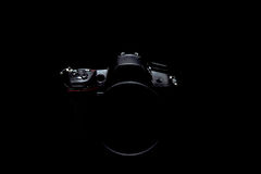 Foto di riserva scura/immagine della macchina fotografica moderna professionale di DSLR Fotografia Stock