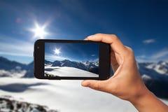 Foto die op smartphone schieten Stock Afbeeldingen