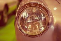 Foto do close-up de faróis retros do carro Imagens de Stock