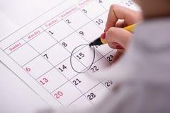 Foto do close-up do calendário com uma referência circundada Imagem de Stock Royalty Free