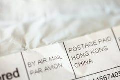 Foto do detalhe - endere?o no envelope do pacote do material pedido do eshop chin?s Compra dos varejistas em linha em ?sia imagens de stock royalty free