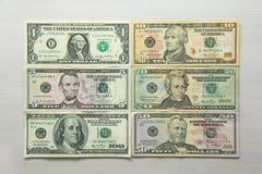 Foto do dinheiro Dólares de papel das denominações diferentes - 1, 5, 10 Foto de Stock