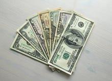 Foto do dinheiro Dólares de papel das denominações diferentes - 1, 2, 5, Foto de Stock