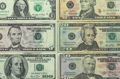 Foto do dinheiro Dólares de papel de denominações diferentes Imagens de Stock