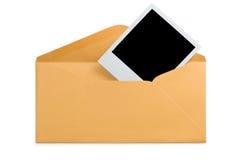 Foto do instante do envelope e do espaço em branco Fotos de Stock Royalty Free