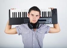 Foto do menino com piano imagens de stock royalty free