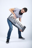 Foto do menino com piano foto de stock