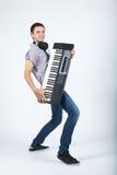 Foto do menino com piano fotografia de stock