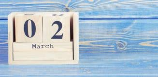 Foto do vintage, o 2 de março Data do 2 de março no calendário de madeira do cubo Fotografia de Stock