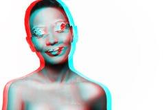 Foto eines Modells des jungen Mädchens mit einem afrikanischen Blick Stockfotografie