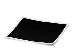 Foto en blanco que miente en la superficie blanca en perspectiva Imágenes de archivo libres de regalías