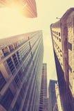 Foto estilizado retro dos arranha-céus em Manhattan no por do sol, NYC Foto de Stock Royalty Free