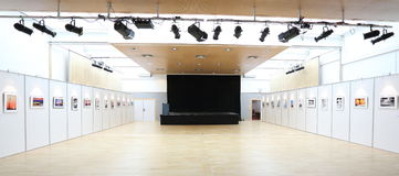 Foto-Exposition in assembly hall. Foto exposition ready to start. A stage has been erected for musicians, mobile walls for the pictures. The Fotos are all my own Stock Images