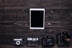 Foto för bästa sikt av kameror och minnestavladatoren Arkivfoton