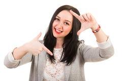 Foto feliz do quadro da mulher com dedos Fotografia de Stock Royalty Free
