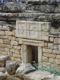 Foto form Efes. Efes ancient ruins. Original stones. Three sign in the entrance to the tomb Stock Images