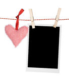 Foto istantanea in bianco e cuore rosso Fotografia Stock