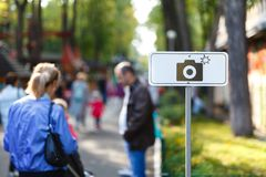 Foto location sign in park stock image