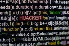 Foto macra de la pantalla de ordenador con código fuente del programa y de la inscripción destacada del SECUESTRADOR en el centro imagen de archivo libre de regalías
