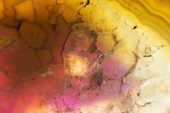 Foto macro de uma fatia colorida da rocha da ágata Imagens de Stock