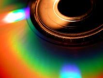Foto a macroistruzione della priorità bassa di incandescenza CD immagine stock libera da diritti