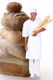 Foto-montaje del panadero de la mujer foto de archivo